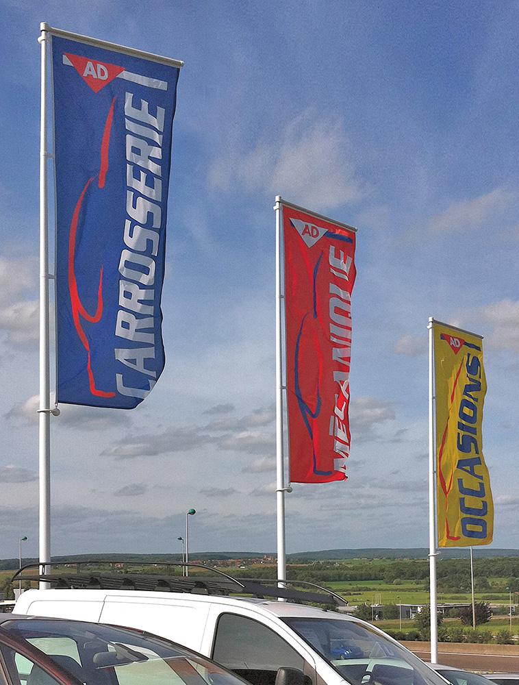 Planete Auto Services drapeaux